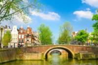 Amsterdam Super Saver: City Sightseeing Tour and Saloon Boat Cruise with Sparkling Wine