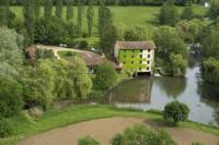 Panoramic helicopter tour of the picturesque Veyle River Watermills