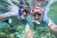 Punta Cana Party Cruise with Snorkeling and Parasailing