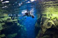 Snorkelling at Silfra in Crystal Clear Water between Two Tectonic Plates