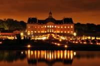 Vaux-le-Vicomte Evening Helicopter Tour from Paris Including Gourmet 3-Course Champagne Dinner, Fireworks and Limousine Return Transport